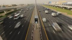 Nonstop traffic at Sheikh Zayed road, time lapse from above carriageway - stock footage