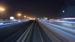 Modern driver-less metro train rush forward, along night Dubai, POV view Stock Footage