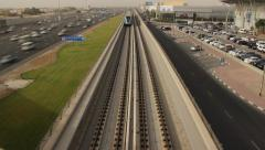 Elevated Dubai Metro railway, train quickly pass, view from above, time lapse Stock Footage