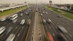 Busy traffic at Sheikh Zayed road, time lapse from above carriageway Stock Footage