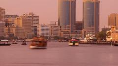 Dusk to darkness time lapse, water traffic on Dubai Creek, many small Abra ferry Stock Footage