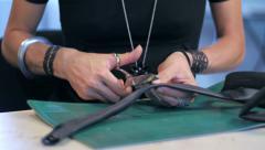 Jewelry maker cutting gum slide Stock Footage