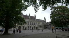 People walking in front of the city hall in Burg in Bruges Stock Footage