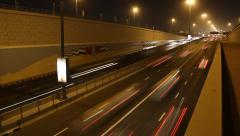 Rapid night traffic at Sheikh Zayed road underpass exit, time lapse shot Stock Footage