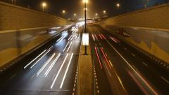Fast non-stop night traffic at city highway moving down to underpass Stock Footage