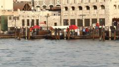 Abra ferry boat quickly approach pier, passengers go to land, Bur Dubai wharf Stock Footage