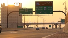 Financial Centre road at sunset, very small traffic, few cars drive at viaduct Stock Footage