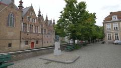 Statue of Frank Van Acker near Dijver Canal in Vismarkt, Bruges Stock Footage