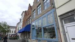 View of an antique shop and a seafood restaurant on Steenhouwersdijk in Bruges Stock Footage