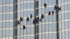 Workers on rope clean Burj Khalifa facade windows, time lapse shot Stock Footage