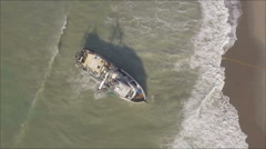 Abandon shrimp boat beached in high surf Stock Footage