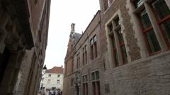 Blinde-Ezelstraat leading to Vismarkt and people walking in Bruges Stock Footage