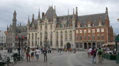 Cars, horse carriage and people in Mark, Bruges Stock Footage
