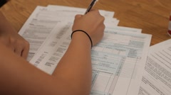 Woman Filling Out Tax Forms Stock Footage