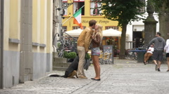 Couple kissing in front of Bistro de Pompe on Kleine Sint-Amandsstraat in Bruges - stock footage