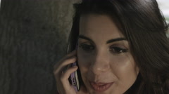 Young beautiful woman talks with phone excitedly Stock Footage