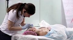 Woman having botox treatment in beauty salon - stock footage