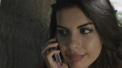 Young beautiful woman talks with telephone - stock footage