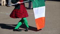 Irish dance for St. Patrick's Day with national Irish flag Stock Footage