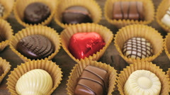 Assorted chocolates on wood table. Stock Footage