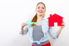 Stock Photo of Woman and paper house. Housing real estate concept