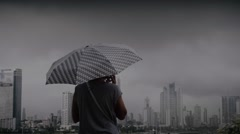 Woman contemplating panama cityscape - stock footage