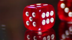 Playing red Casino Dice Cubes on a Glass Table Stock Footage