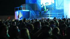 Crowd making party at a rock concert. Hands hold cameras with digital displays Stock Footage