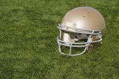 Football Helmet on Artificial Turf Stock Photos