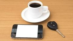 Coffee cup and phone and car key Stock Photos