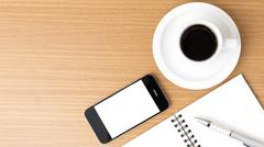 coffee cup and phone and notepad - stock photo