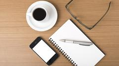 Coffee,phone,notepad and eyeglasses Stock Photos