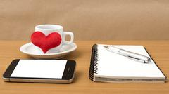coffee,phone,notepad and heart - stock photo