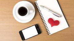 Coffee,phone,notepad and heart Stock Photos