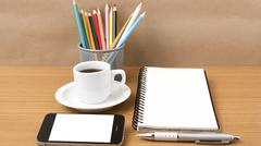 Coffe,phone,notepad and color pencil Stock Photos
