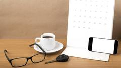 Coffee,phone,car key,eyeglasses and calendar Stock Photos