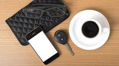 coffee,phone,car key,eyeglasses and wallet - stock photo