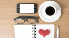 coffee,phone,eyeglasses,notepad and heart - stock photo