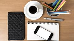 Coffee,phone,eyeglasses,notepad,wallet and color pencil Stock Photos