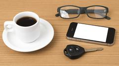 coffee cup and phone with car key - stock photo