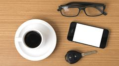 Coffee cup and phone with car key Stock Photos