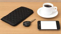 Coffee cup with phone car key and wallet Stock Photos