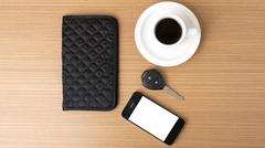 coffee cup with phone car key and wallet - stock photo