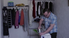Man ironing clothes iron Stock Footage