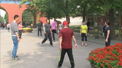 Players involved in a game of jianzi in beijing china Stock Footage
