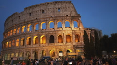 Exterior view of the colosseum at dusk in rome Stock Footage