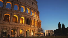 Rome's colosseum and arch of constantine at dusk Stock Footage