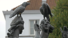 Sculpture representing two crows standing on the women's heads, Bruges Stock Footage