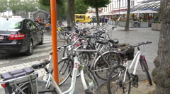 Bikes parked near 't Zand Square in Bruges Stock Footage