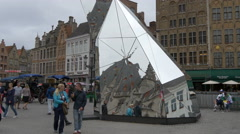 Adults and children walking near the DiamondScope in Bruges Stock Footage